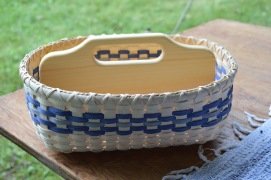 Cabin Boy Basket with wooden bottom and handle.